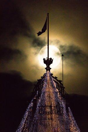 Tours of Edinburgh: Supermoon over the Clock Tower of the Balmoral Hotel, Princes Street, Edinburgh.