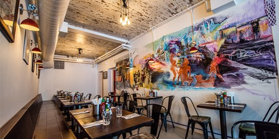 Huge wall mural inside with cozy seating for groups of all sizes We