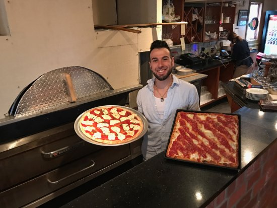 Dante's Italian Cuisine & Brick Oven Specialty Pizza: Owner with Pizzas