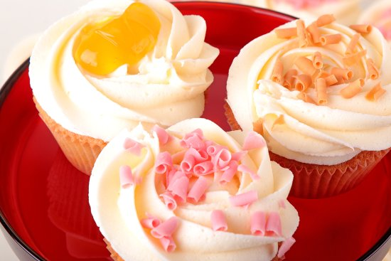 Three of our fruity cupcakes - Pear Cupcake, Lemon crème Cupcake, and Strawberry Cupcake.