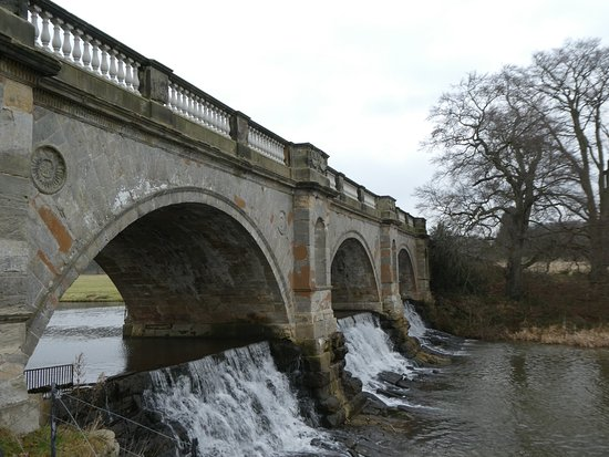 The old stone bridge in the grounds of Kedleston Hall