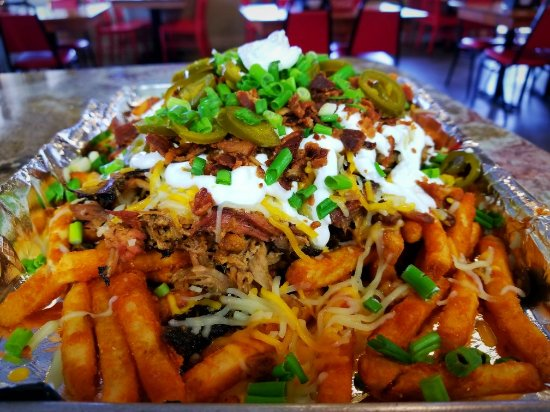 "Vidalia, LA: ""Pig Sty"" Fries - Cajun Fries piled high with meat, beans, cheese, sour cream, bacon, jalapenos"