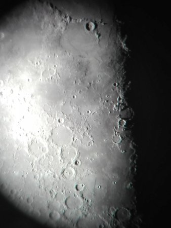 Sutherland, South Africa: Photo of the Moon`s surface through telescope