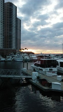 Sunset view over the marina from Joe's Crab Shack in downtown Fort Myers, FL.