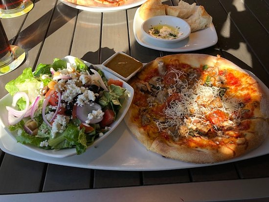 Lunch combo of pizza and salad.