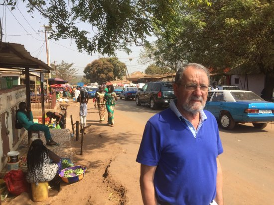 Bissau Main Market: in the market, ppl passing by
