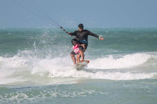 El Cuyo, Mexiko: taking a young one for a kitesurfing ride