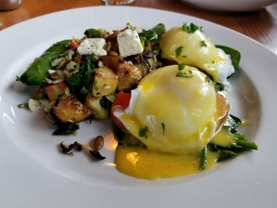 Lapellah : Eggs Benedict w/Canadian Bacon OVER Spinach w/vegetable hash-yes, it's really good!!