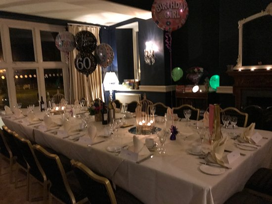Private lounge set up for 60th birthday party Picture of Hallmark