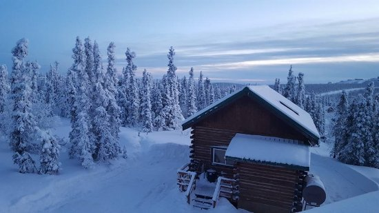 Aurora Borealis Lodge: Logan's chalet at sunset