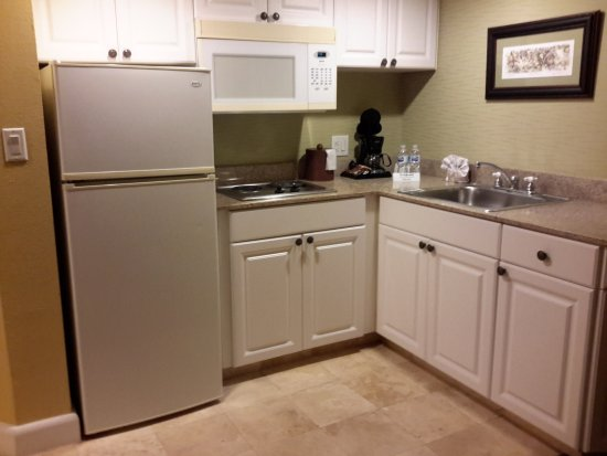 Tradewinds Island Grand Resort Kitchenette With Apartment Size Fridge Stove And Microwave