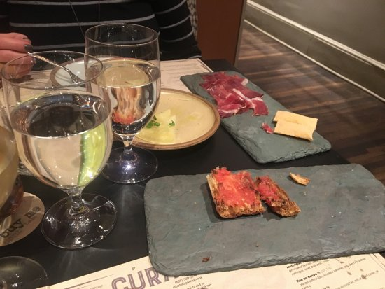Cúrate: Iberico ham, bread with olive oil and tomatoes, white asparagus. Simple food done perfectly.