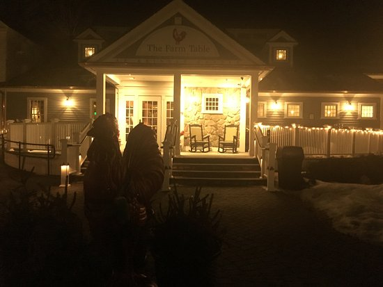 Bernardston, MA: Restaurant at night. Rooster statue (shadowlike) in the forefront.