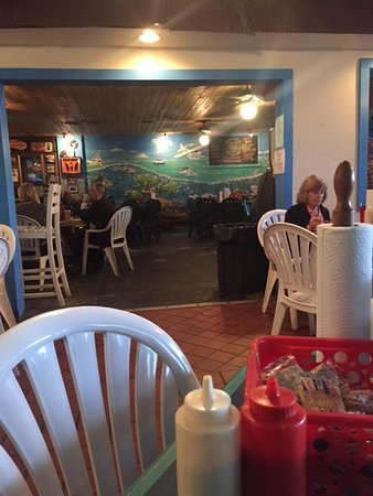 Bimini's Oyster Bar and Seafood Cafe: View from the restaurant looking toward the bar area.