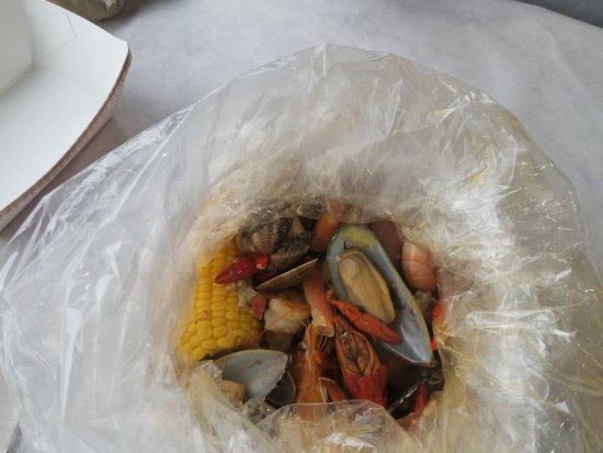 Streamwood, IL: Top of the bag and it's full of shrimp, crawfish, mussels, clams, sausages, corn, potatoes and c