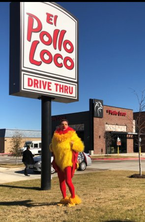 Silly Chicken Mascot waving to traffic at El Pollo Loco in Bedford, TX