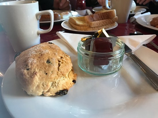 Rolleston on Dove, UK: Warmed scone and jam with morning coffee
