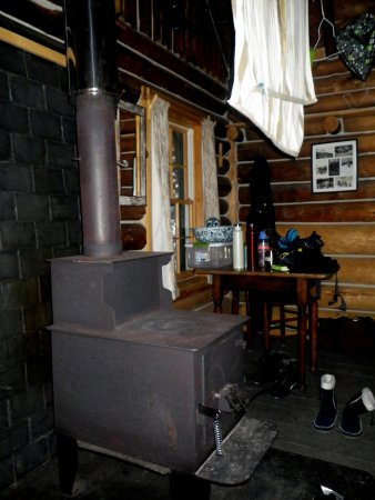 "AMC Gorman Chairback Lodge and Cabins: Wood stove inside ""Bobcat"" cabin"