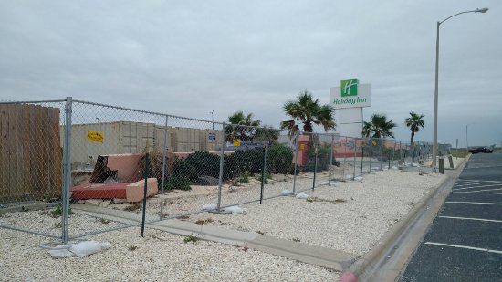 Holiday Inn Corpus Christi - N. Padre Island: Looks abandoned.  Much damage to roof and northwestern face.  All fenced off with no activity on