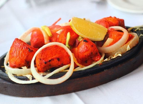 Tandoori chicken tikka sizzling hot from our tandoori oven for Aroma fine indian cuisine toronto on canada