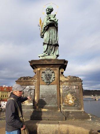 Prague Airport Transfers: Ross explaining the statue of St John