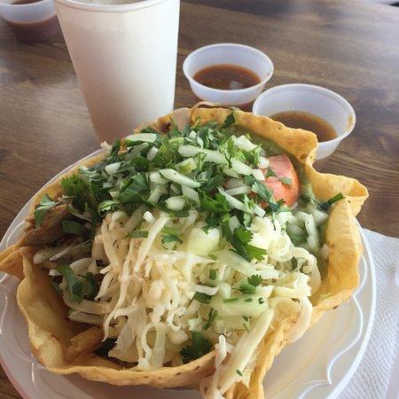 Taco De Mexico: Tostada salad with pork carnitas and Horchata
