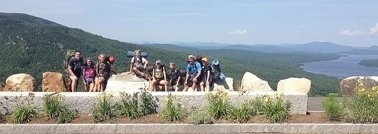 Oquossoc, ME: EcoVenture Campers at Height of Land