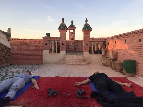 Sally Goldfinger Yoga & Ayurveda: Outdoor Yoga session in Marrakech. Relaxation towards the end of class - bliss
