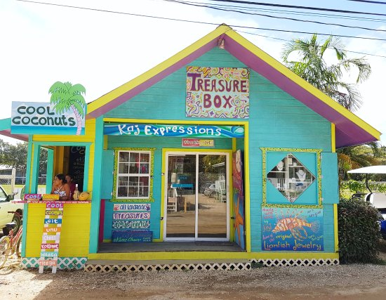 Our brightly colored  Treasure Box store front is a POP on Placencia's Main Street