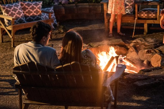 Elkton, OR: guests cozying up around the fire
