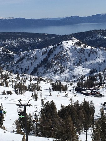The Village At Squaw Valley: The gorgeous waters of Lake Tahoe can be seen while skiing at Squaw Valley.