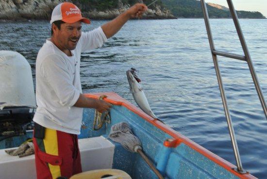 Verana : Moy taking care of a bonita, fishing activity