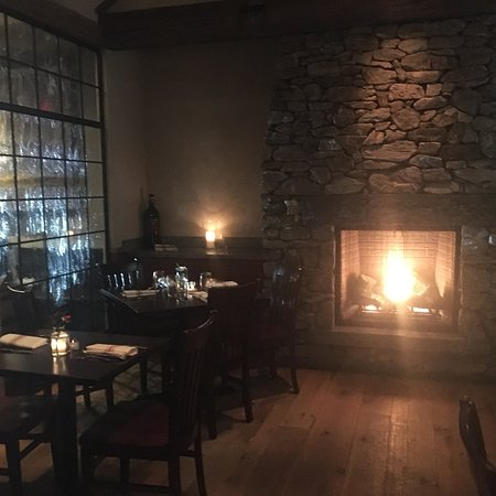 Woodbury, CT: The manager charges $500 fee for a table of 3 near this fireplace.