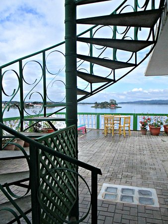 Hotel Casa Amelia: The spiral staircase leading to my room. Any guest can make use of the roof terrace.