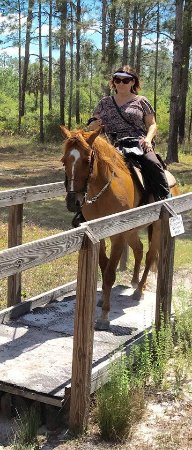 """Parrish, FL: Riding the horses over some of the """"obstacle course"""" items available on the trails"""