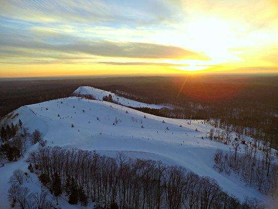 Cadillac, MI: Sunset over the ski hillls