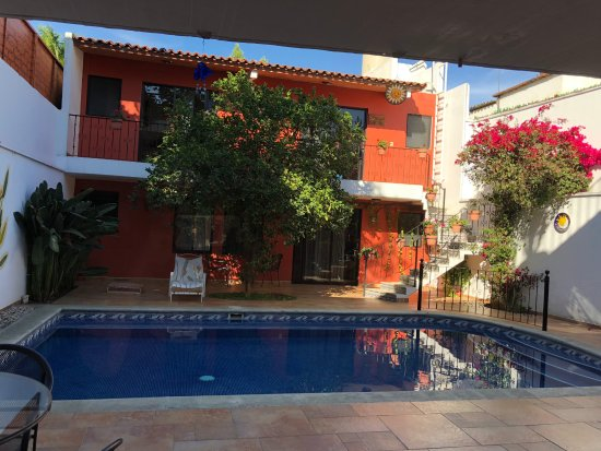 Oaxaca Ollin: private pool area with lounge chairs and eating area.