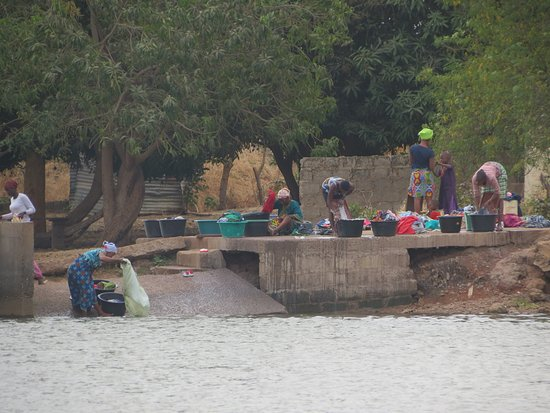 Janjanbureh, Gambia: local women doing the laundry near the ferry jetty