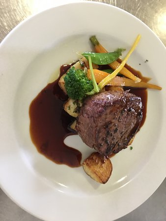 Aged Beef Eye Fillet, duck fat potatoes, summer greens, port wine jus
