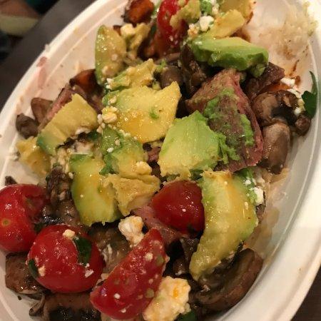 Fresh tasty veggies, quinoa, spicy sauce on chicken Energy
