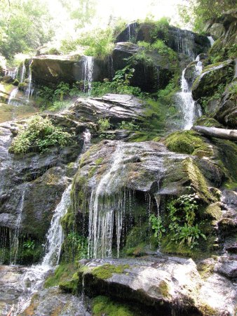 Old Fort, NC: Water at this portion of Catawba Falls spills in many avenues over moss-covered rocks.