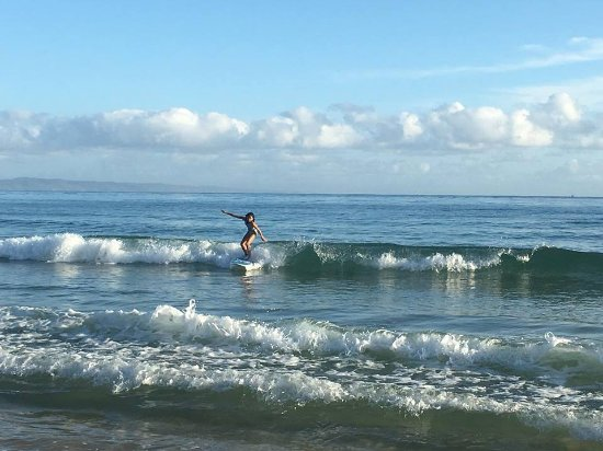 Merrick's Noosa Learn to Surf: Song enjoying an early morning surf at Noosa main beach