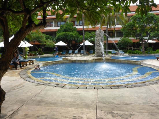 Bali Rani Hotel: Childrens pool view from restaurant. Deeper pool behind. Rooms around pool.