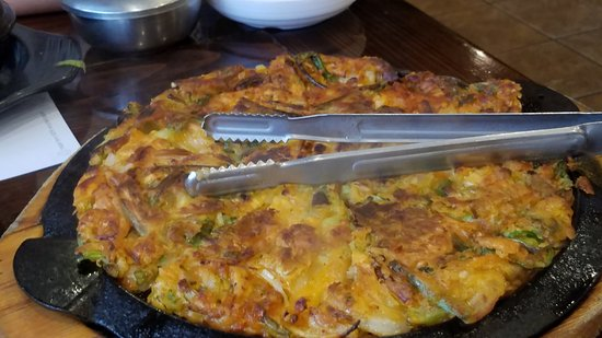 Doraville, GA: HUGE scallion pancake, comes to the table sizzling and hot, this is the seafood version
