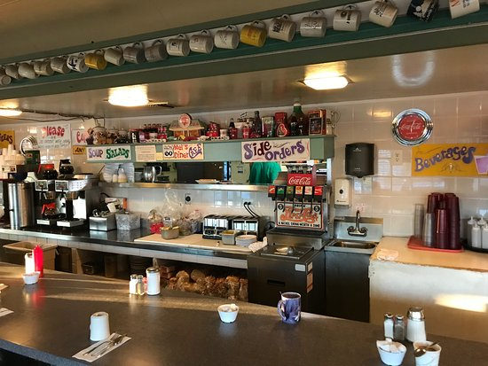 Mel's Diner: Coffee cups adorn the crown molding all the way around inside