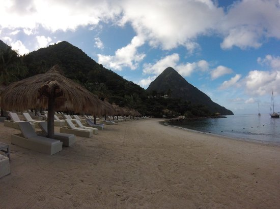 Sugar Beach, A Viceroy Resort: Beach area and chairs with Umbrellas - Go early to get an Umbrella