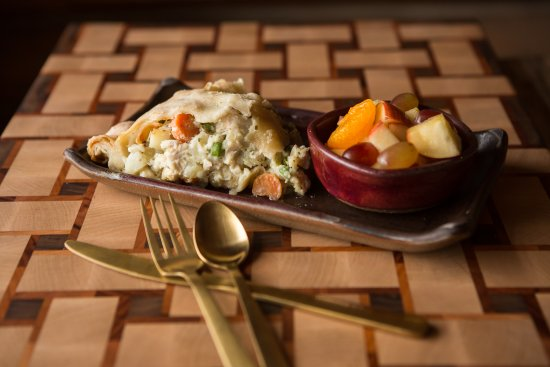 The Coffee Pot Bakery Cafe : Our scrumptious best-seller, Chicken Pot Pie, paired with a fresh cup of fruit.