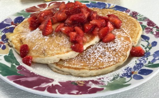 Sunflower Cafe: Special - White chocolate cheese cake pancakes topped with fresh strawberries & powdered sugar