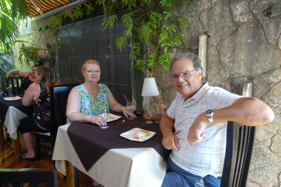 Restaurante La Casa: Our table seemed to be part of the patio/garden originally, but has a roof now.