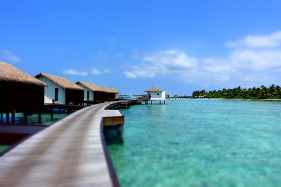 The Residence Maldives: Water villa, on the left are those sunset facing